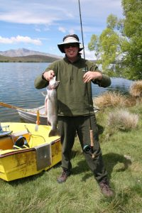 Happy angler... Mark Tomlinson, of Ashburton, at Lake Alexandrina with his only fish for the morning, a 2.2kg rainbow trout.